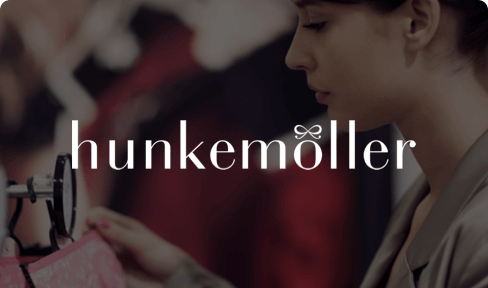 Hunkemöller logo on photo of customer shopping for lingerie