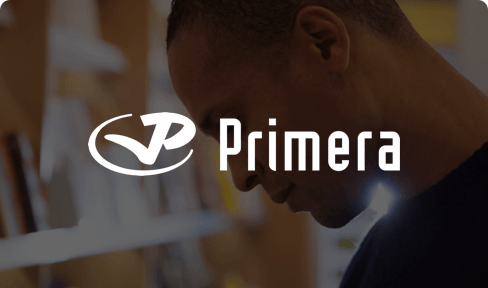Primera logo on image of customer inside a Primera store